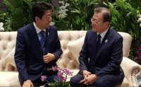 Moon, Abe hold 11-min summit in Bangkok; agree to resolve conflict through dialogue