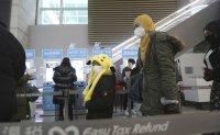 Passengers from China undergo strict quarantine screening