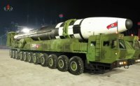 North Korea shows off new ICBMs at parade