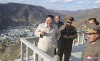 North Korean leader visits typhoon-hit area, warns of 'defeatism'