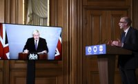 British PM says 'escape route in sight' from pandemic
