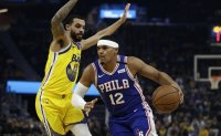 Curry-less Warriors rally to beat 76ers 118-114
