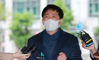 Defector activist grilled by police over anti-North Korea leafleting