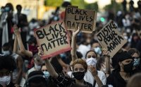 Protests defy curfews across US; 700 rioters arrested in NYC