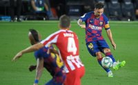 Messi scores 700th goal, Barcelona held 2-2 by Atletico