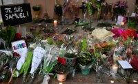 Nine arrested over France teacher beheading