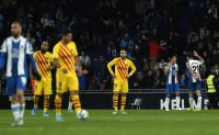 Barca draw with Espanyol, lead with Madrid at midway point