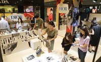 International luxury brands flourish while local labels perish