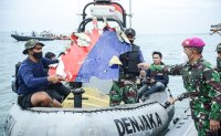 Indonesia intensifies search for crashed plane's black boxes