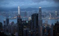 Hong Kong's currency soars, defying speculation of capital flight