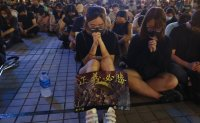 Hong Kong protesters pray, gird for unauthorized march