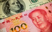 China asks banks to suspend counter-cyclical factor in yuan fixing: Reuters