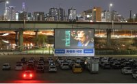Drive-in cinemas enjoy sales boom over virus fears