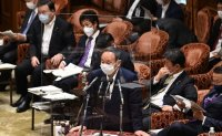 Support for Japan govt hits new low as vaccinations progress slowly
