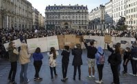 'We are not afraid': France rallies after beheading of teacher