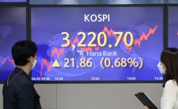 KOSPI closes at new high