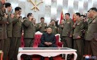 North Korean leader confers pistols to officers on armistice anniversary