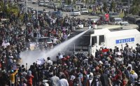 Water cannon fired at protesters as tensions rise in Myanmar