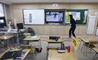 Decision on online classes hits double-income families
