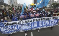 Indonesians take to the streets to protest new labor law