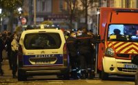 Priest shot outside French church, suspect arrested