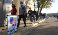 US settles in for long count, with early results close in many states