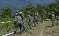 Two Koreas begin clearing mines along DMZ