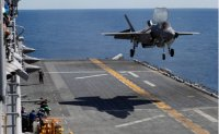 Japan to spend more on defense to counter China