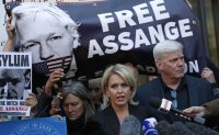 WikiLeaks' Assange hauled from embassy, faces US charge