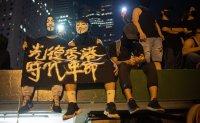 Hong Kong police say student arrests at protests increase