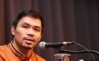 Boxing icon Pacquiao takes over as head of Philippine ruling party