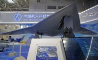 China unveils stealth combat drone