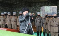 North Korea fires missiles at 'unexpected' time