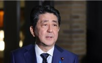 Japan's ex-PM Abe questioned by prosecutors over political funding case