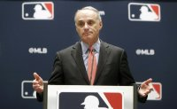 MLB cuts senior staff pay by 35%, pays all staff through May