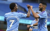Man City beats Arsenal in muted atmosphere as PL returns
