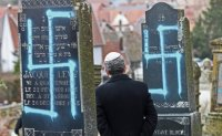 Macron vows crackdown as thousands rally against anti-Semitism