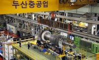Doosan Heavy under pressure to sell more assets