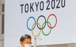 Japan, IOC set July 23 next year for start of delayed Olympics - Kyodo