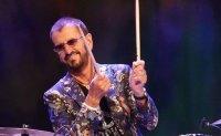 Stars celebrate 50th anniversary of Woodstock music festival