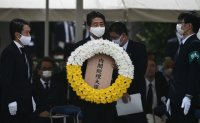 Japan's PM Abe to avoid visit to war-linked shrine on 75th war anniversary