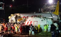 Three dead, scores hurt, in Turkey plane accident