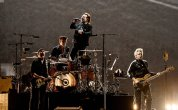 U2 says 'women of the world unite' in Korea