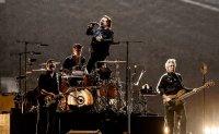 U2 says 'women of the world unite' in Korea
