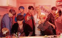 BTS becomes 1st K-pop act to spend 1 year on Billboard 200