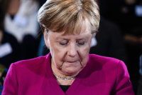 Germany's under-fire Merkel plans era-ending exit in 2021
