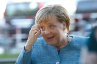 Merkel urges companies to switch focus from Asia to Africa