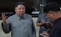 Kim warns S. Korea: 'No more weapons development, military drills'