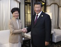 Xi meets Lam in 'vote of confidence' over Hong Kong protests
