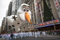 Snow, winds wane after tangling traffic, threatening parade
